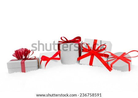 Still life with Christmas gifts covered with snow isolated on white