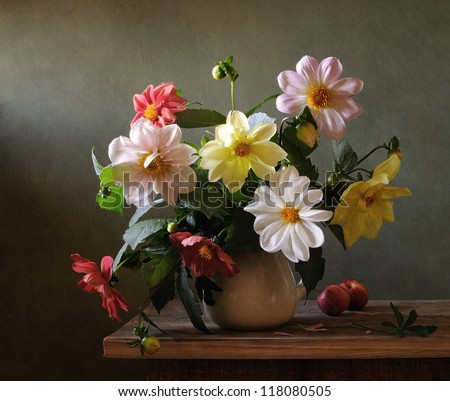 Still life with chrysanthemums and red apples - stock photo