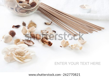 Still life with cinnamon, perfume sticks, aroma candle and ornamental dried flowers setting - stock photo