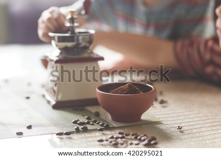 still life with coffee beans and old mill on the table - stock photo