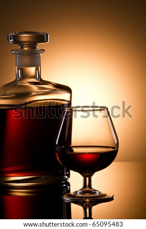 Still life with cognac glass and bottle - stock photo