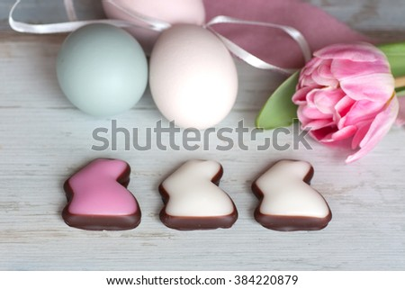 Still life with colorful Easter eggs and chocolate bunnies