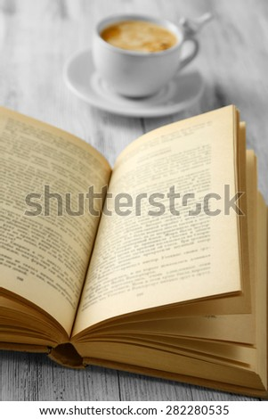 Still life with cup of coffee and book, close up