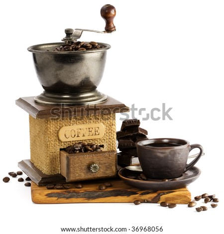Still life with cup of coffee and coffee-mill over white