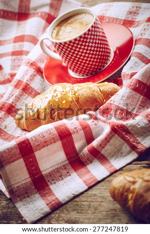 Still life with cup of coffee and croissant - stock photo