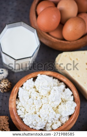still life with dairy products as milk, cheese cottage cheese eggs and bread  - stock photo