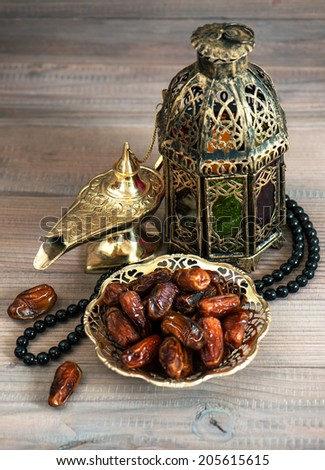 Still life with dates, arabic lantern and rosary. Oriental decoration - stock photo