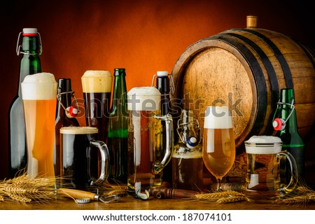 still life with different bottles, glasses and mugs of beer drinks - stock photo