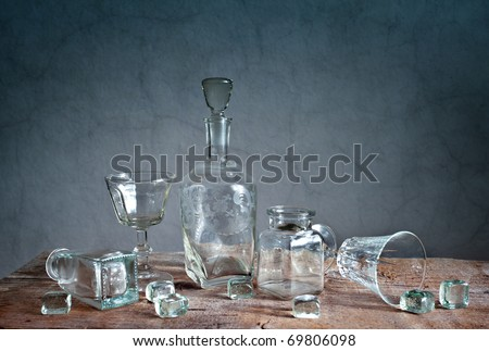 Still Life with differently shaped glass bottles