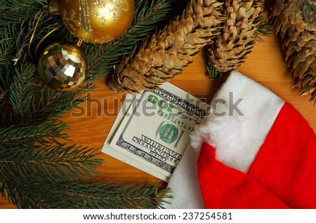 Still life with dollar bills and christmas accessories. - stock photo