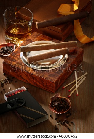 still life with drink and cigars - stock photo