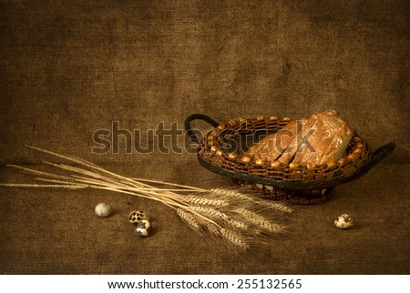 Still Life with ears of wheat and bread - stock photo