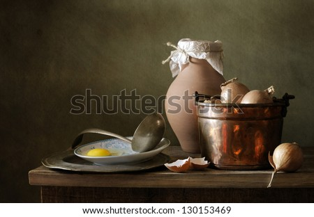 Still life with eggs and onions - stock photo