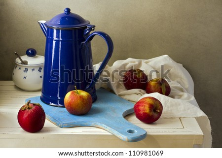Still life with enamel vintage jug and fresh apples - stock photo