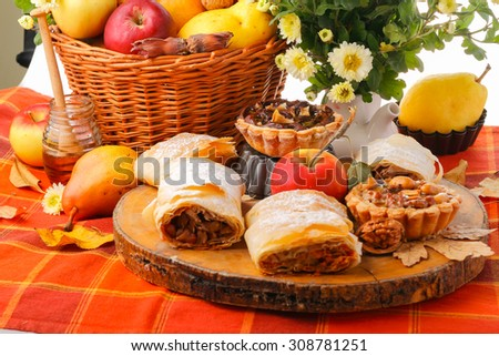 Still life with fall fruits and different type of pie - stock photo