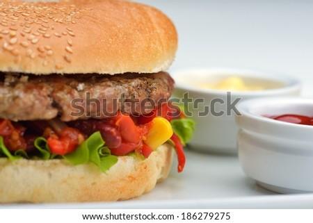 still life with fast food hamburger menu, french fries, soft drink and ketchup - stock photo