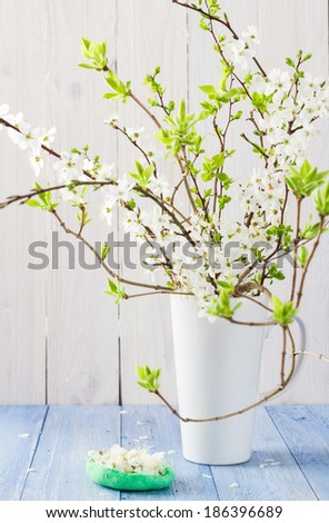 Still Life with flowering branches in a vase - stock photo