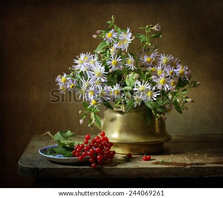 Still life with flowers and red berries - stock photo