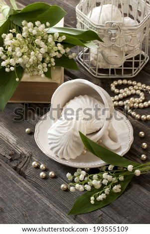 Still life with flowers and sweets - stock photo