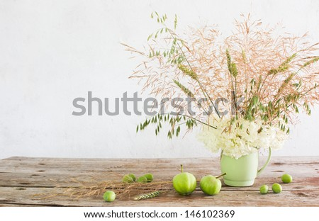 Still-Life with flowers in ceramic can - stock photo