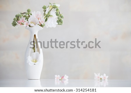 still life with flowers in white vase