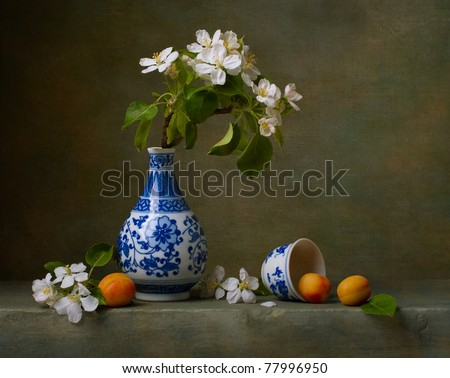 Still life with flowers of apple and apricots - stock photo