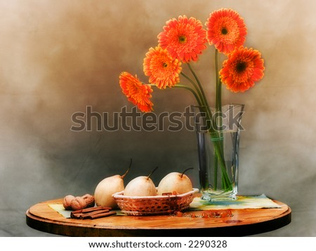 Still life with flowers, pears, nuts and amber - stock photo