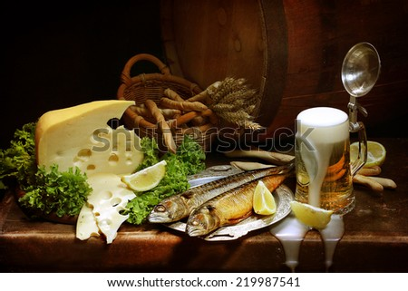 Still-life with foamy beer both grain sticks and fresh cheese and smoked fish - stock photo