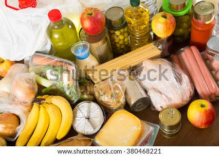 Still life with food purchases from supermarket - stock photo