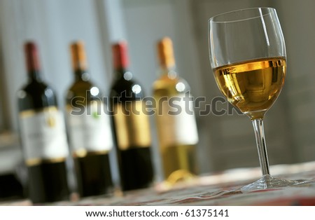 Still-life with four wine bottles and glass - stock photo