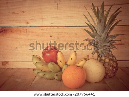 Still life with Fresh fruits  on wooden table -  vintage style color effect - stock photo