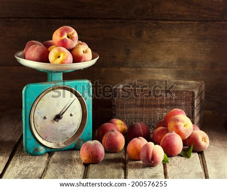 Still life with fresh peaches on wooden background - stock photo