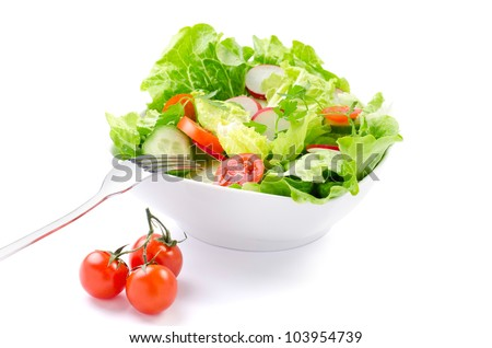 still life with fresh salad in a white plate, fork and cherry tomatoes
