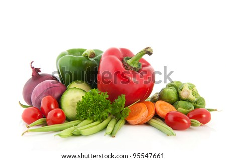 Still life with fresh vegetables isolated over white background - stock photo