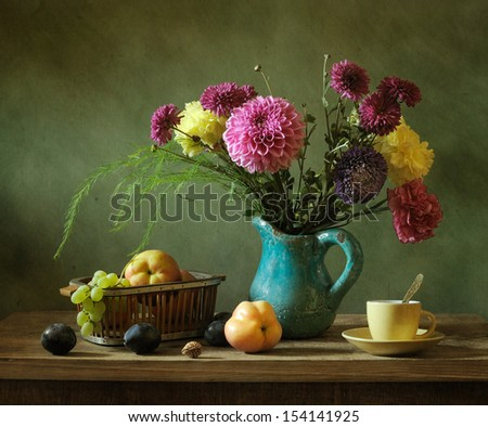 Still life with fruit and a bunch of flowers - stock photo
