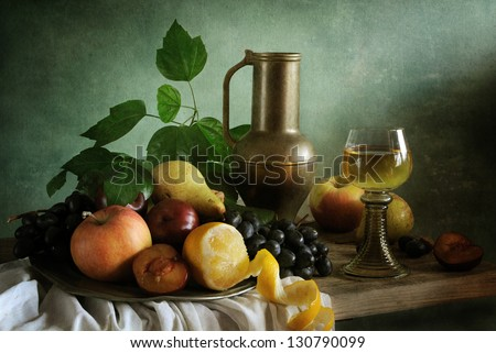 Still life with fruit and a glass of wine - stock photo