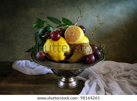 Still life with fruit and drapery - stock photo
