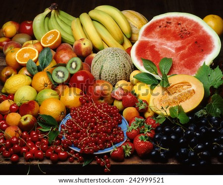 Still life with fruit. Cherries, currants, grapes, kiwi, oranges, apples, melons, bananas, peaches, strawberries, lemons,watermelon  - stock photo