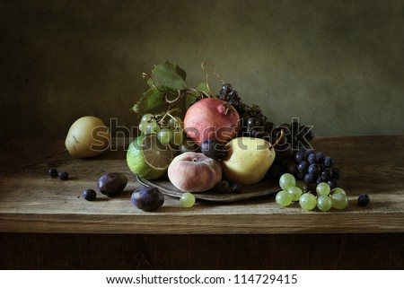Still life with fruit in a silver plate - stock photo