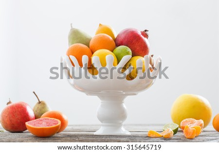 still life with fruits in vase