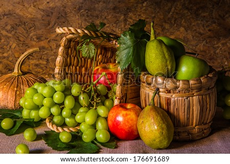 Still life with fruits placed in a basket  made of natural materials.