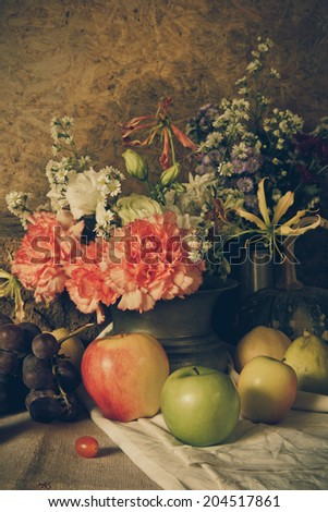 Still life with Fruits were placed together  a vase of flowers beautifully.