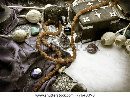 Still life with gemstones and other astrological symbols - stock photo