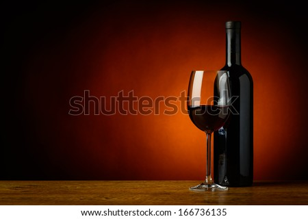 still life with glass and bottle of red wine and copyspace