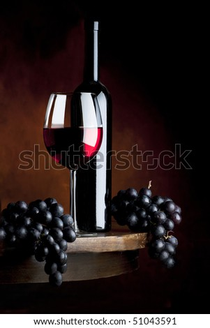 still life with glass of  red wine - stock photo