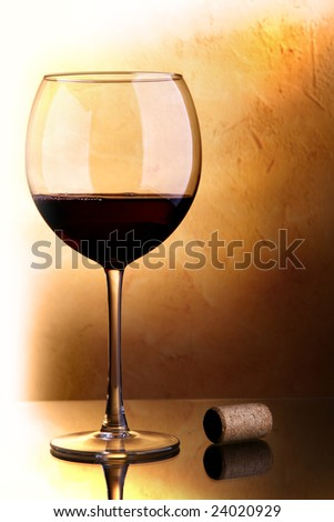 Still-life with glass of red wine and cork