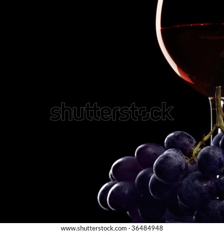 Still-life with glass of red wine and grapes - stock photo