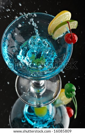 Still life with glass with drink on the black background
