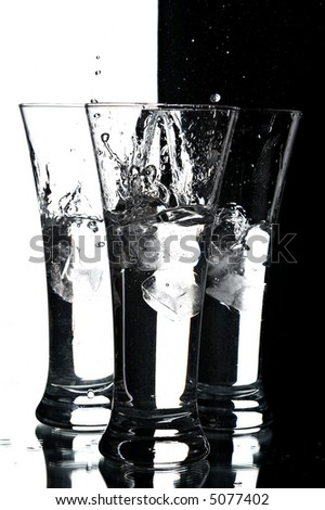 still life with glasses on the white and black background - stock photo