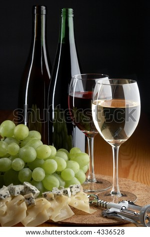 still life with grape, cheese, red and white wines on the black background - stock photo